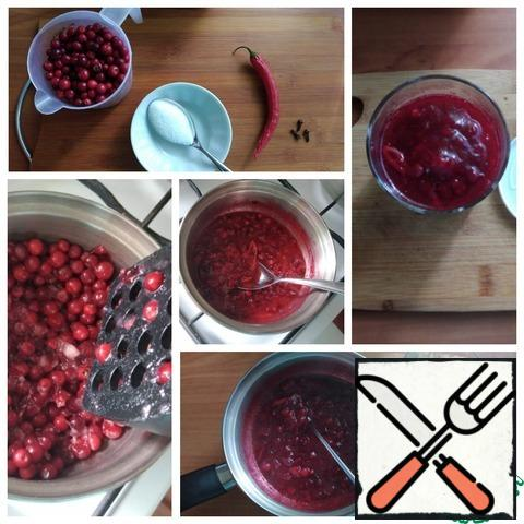 You need to make the sauce at home and take it with you on a picnic. It will go with any meat. I weighed the cranberries. Took 180 g. I poured it into a saucepan, put it on the fire, and mashed it with a mash. I like the lingonberries to feel in the sauce. You can also break it with a blender. This is optional. Put 3 pieces of cloves, sugar and chili pepper to the cranberries, cutting off 2 cm from it. I removed the seeds and cut them into thin rings. I got 7 of them. brought to a boil and Boiled the sauce a little, just 5 minutes. Ready. Put it in a suitable jar with a lid. For the future, you do not need to cook it, although it will stand in the refrigerator for 5 days. The sauce is suitable for any meat. I made it for the Turkey today.