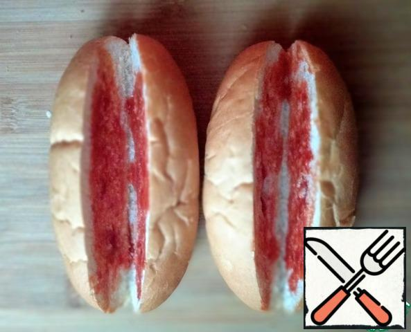 Brush the inside of each bun with ketchup.