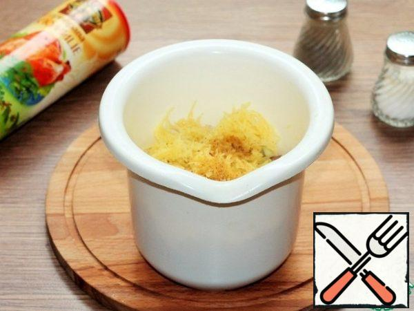 Grated peeled raw potatoes on a medium grater.