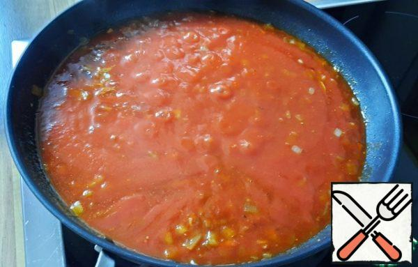 Add the sauteed tomatoes and 2 tablespoons of adjika, bring to a boil, and simmer for 20 minutes, stirring occasionally.