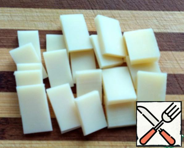 Cut the cheese into small rectangles.