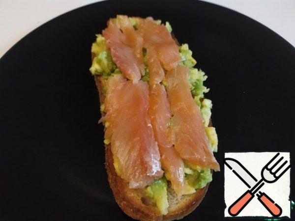 Put the fish on the avocado.