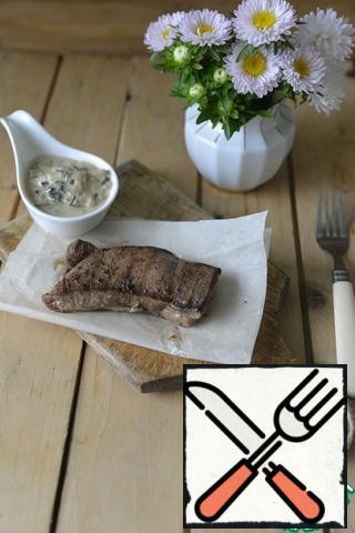 Serve grilled Turkey with creamy mushroom sauce.