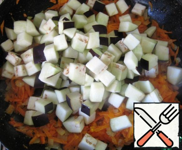 Once the carrots are soft, add the eggplant. Stir and continue to fry the vegetables over low heat.