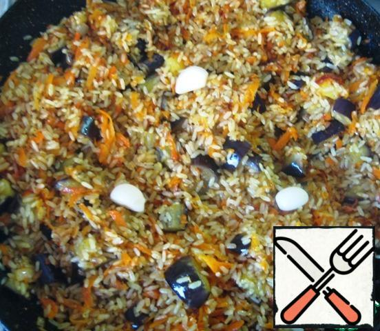 Add the garlic cloves.