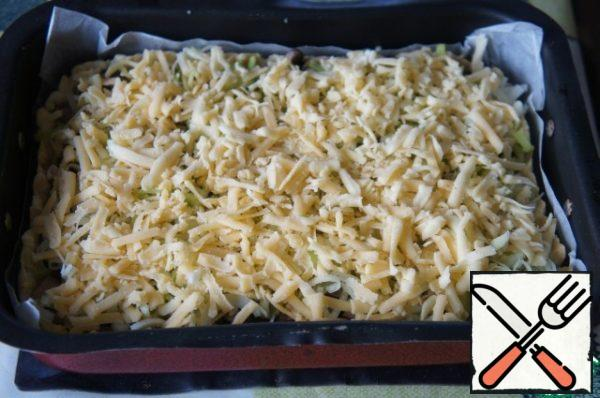 Pour the filling evenly, top with cheese and put it back in the oven. Bake at 180-200*C for 25 minutes.