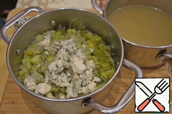 Remove the soup from the heat and drain most of the broth into a small saucepan.