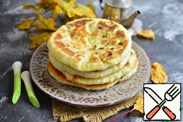 Fried Tortillas with Onions and Cheese Recipe