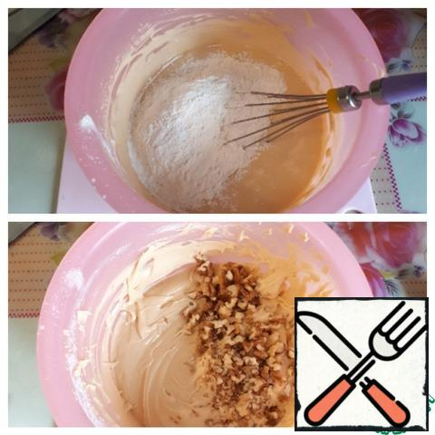Add soda (slaked), salt and flour, knead the dough, put walnuts, chopped with a knife.