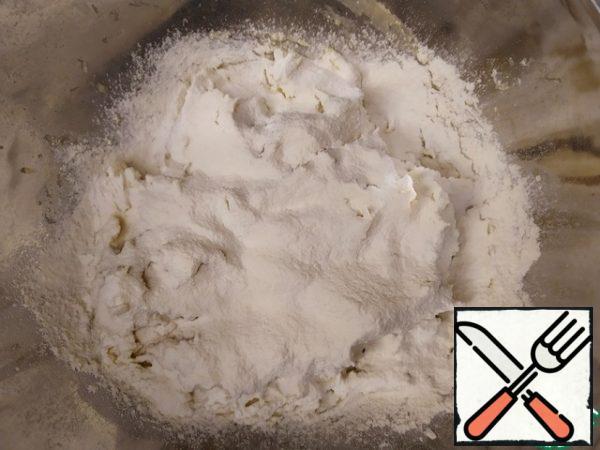 Start gradually adding flour and knead the dough.