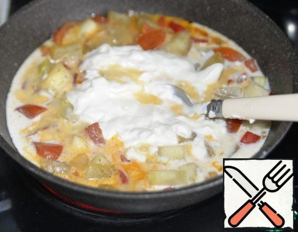Add the sour cream mixture to the pan, stir and simmer for another couple of minutes.