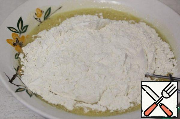 Add the flour mixture and mix.