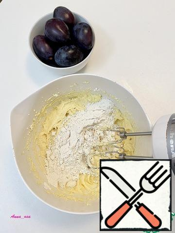 Add the flour in two rounds and bring the mixture to a smooth finish. The dough will be thick.
