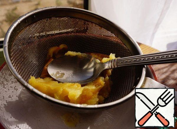 Apple is ground through a sieve.