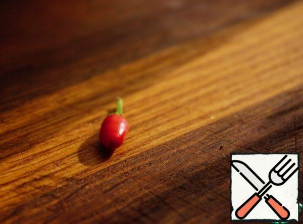 """I have already written more than once, but I repeat, about the fact that I have such a """"magic"""" pepper growing on my windowsill. It is very small, about 1 cm, but so sharp that it will replace the standard chili pepper."""