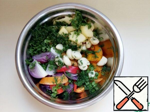 Combine the vegetables in a bowl, cool and add the coarsely chopped herbs, mix gently.