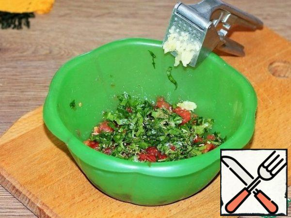 Add the peeled and pressed garlic, chopped herbs, ground coriander and mix.