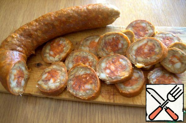 For the filling, I chopped a spicy chorizo sausage with spicy paprika...