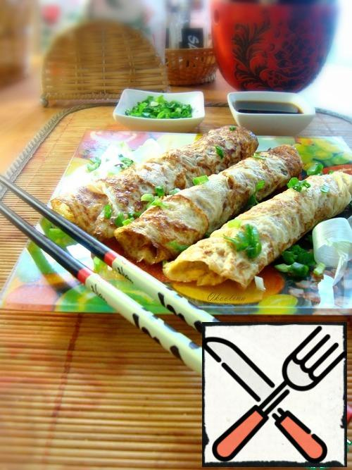 Serve, sprinkle the pancakes with green onions. We eat by cutting off a piece and dipping it in soy sauce.
