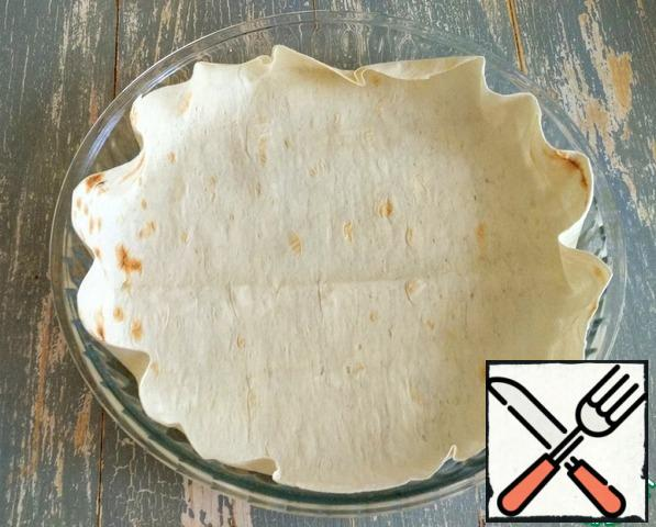 Cover the baking dish with pita bread (optional).