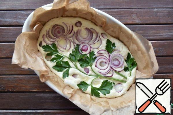 "From this volume of dough, you can form one large or two medium Focaccia. Put the dough on parchment, greased with vegetable oil, giving a round or oval shape. Go over the entire surface of the Focaccia with your fingertips, lightly pressing and forming small depressions. Put any pattern on the surface of the Focaccia using seasonal vegetables of different colors, herbs, mushrooms, olives, olives, capers. You can sprinkle Focaccia with coarse salt or a mixture of dried herbs. As long as you show imagination and ""draw"", the bread will rise noticeably. Before baking, drizzle the Focaccia with olive oil and lightly press the ""pattern"" into the dough. Bake Focaccia in the oven, preheated to 220 degrees for 20-25 minutes."