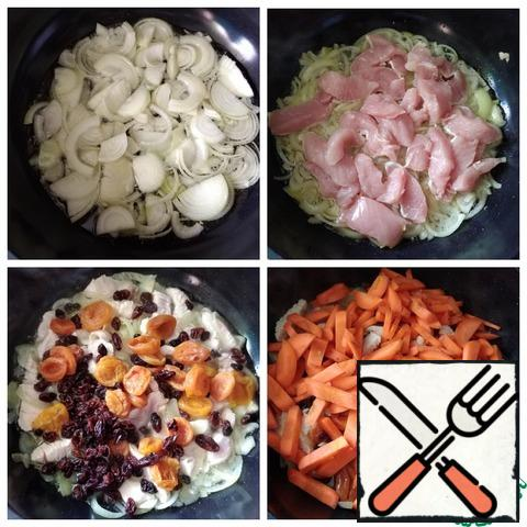 In nature, pilaf is prepared in a cauldron. I will make pilaf on a gas stove in a wok D-28 cm and height-10 cm. Turn on the fire to full, put the wok, spread the onion layer and fill it with sunflower oil. IMPORTANT! The oil should cover the onion completely. I had 175 ml (measured with a measuring Cup). Fry the onion over high heat, constantly stirring with a spatula so that it does not burn. If you burn onions, it will affect the taste of pilaf (it will not be delicious). Onions are Golden. Next, we send the pieces of Turkey, brown them and put dried fruits, mix. Fry all the same on high heat, stirring constantly. Carrot queue. Now reduce the heat to medium and fry everything until half-cooked.