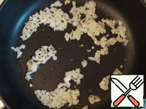 Add the finely chopped garlic and continue to fry.
