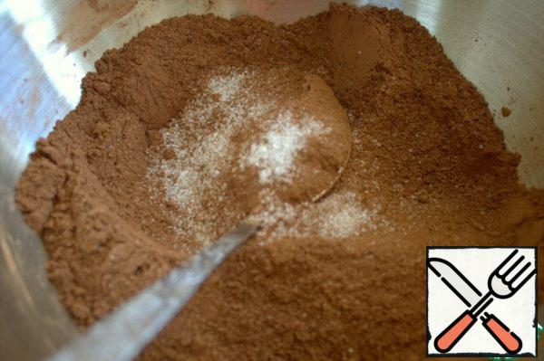 Mix the dry ingredients for the chocolate cake.