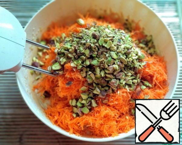 Add carrots and chopped pistachios to the dough.