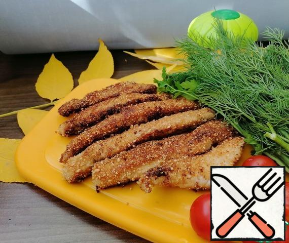 Roll each stick in breadcrumbs and fry in oil for a few minutes on each side over medium heat.