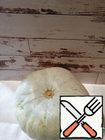 Cut off the top of the pumpkin and use a knife and spoon to get the pulp from the pumpkin and the top.