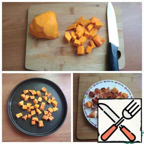 A piece of pumpkin is cleaned and cut into cubes. Place on a baking sheet, salt, sprinkle with Basil and drizzle with olive oil. Put in the oven preheated to T-200 C for 10 minutes. It may take less time, be guided by your oven. Remove and transfer to a plate. Let it cool down a little.