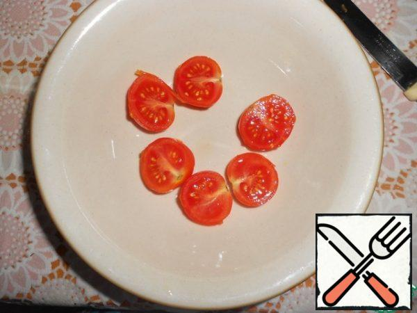 Cherry tomatoes cut into halves.