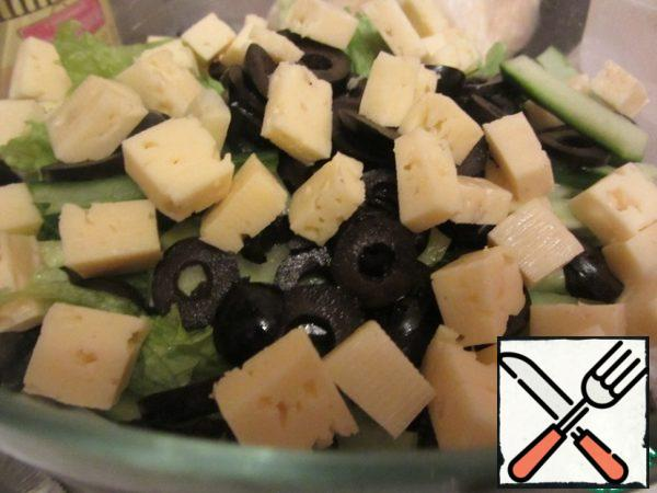 Cheese cut into cubes (not very small), olives-rings.
