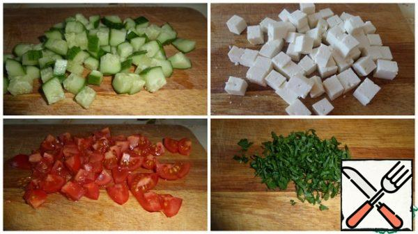 Cut the vegetables into cubes. Chop the greens.