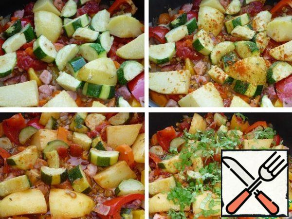 Put the potatoes and zucchini in the pan, add the red hot pepper and vegetable seasoning, and pour in the boiling water. Adjust the amount of water as needed. Simmer, after boiling, under a lid on a low heat for 20 minutes. (until the lentils are ready). Add herbs to the finished stew.
