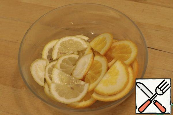 Cut the lemon and orange into semicircles.