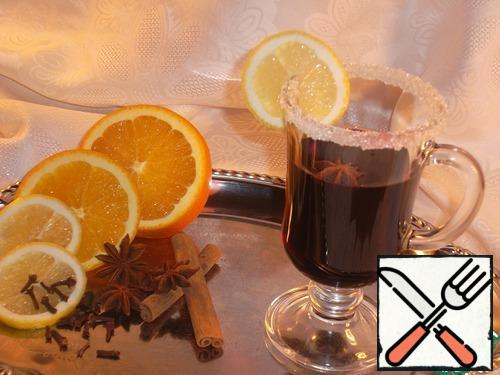 """We throw spices and spices, orange circles (or Apple slices), lemon circles. In order that the cloves would not fall into the ladle when spilling, """"stick"""" it in a circle of orange. All this is periodically stirred. Heat over low heat, slightly not bringing to a boil. In the Internet, """"experts"""" scare: it is necessary to heat exactly to 70... or to 76... or to 78... I Don't know, maybe so, but I never ran for wine with a thermometer – I heated it, whatever was hotter, I didn't bring it to a boil – and order!!! Set aside from the heat, cover with a lid and let stand for 15 minutes…"""