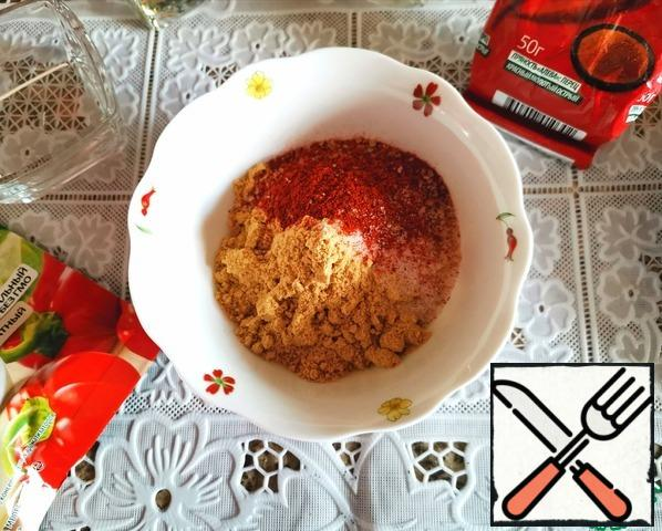 Mix all the dry ingredients: mustard powder, salt, sugar cane, sweet paprika and pepper ground.