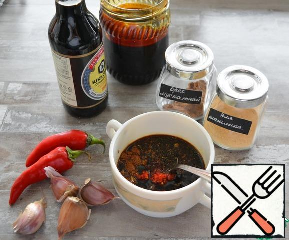 For the marinade, combine soy sauce, minced garlic and hot pepper, molasses, nutmeg and shish kebab spices.