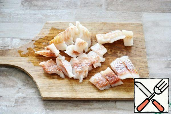 Cut the Pollock fillet into small pieces.