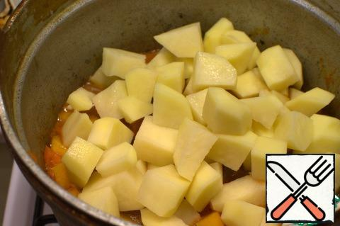 Add the potatoes, salt, pepper and simmer until the potatoes are ready.