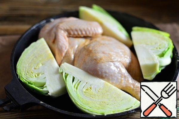 Attach parts of the cabbage to the chicken.