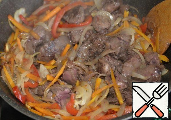 Fry the liver until browned over medium heat for about 5 minutes.