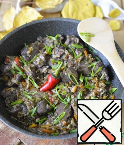 Let the dish brew with the lid closed for 10 minutes. Serve hot, sprinkled with green onions.