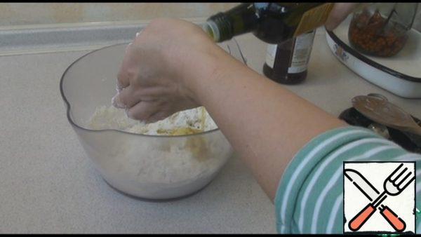 Add the vegetable oil and mix it into the dough. We should make it soft and elastic.