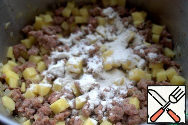 Stir and add flour.