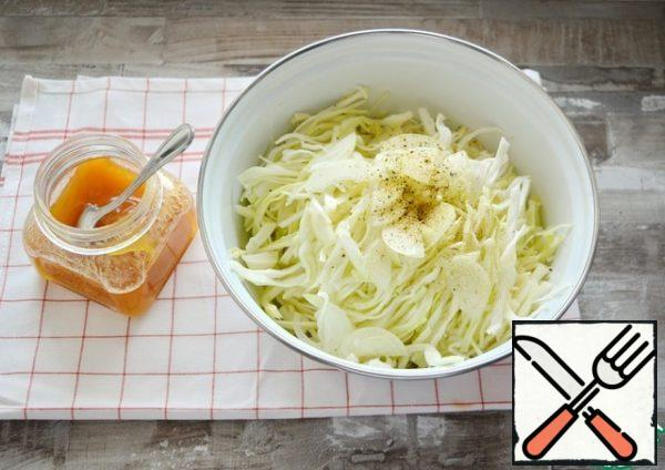 "Chop the cabbage, add the ""lemon pepper"" seasoning, salt, honey, Apple cider vinegar and RUB the cabbage well with your hands so that it lets the juice out."
