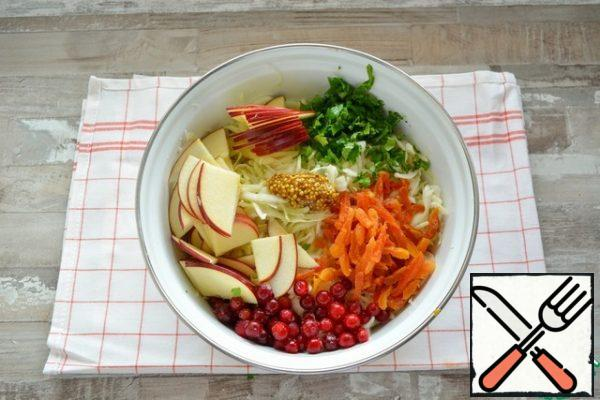 Add the sliced red Apple, chopped parsley, cranberries and chopped dried apricots.Pre-wash dried apricots, if it is very dry, then fill with warm water for 5 minutes.Cranberries can be put in a salad without defrosting, in the process of mixing it will defrost.Add a teaspoon of grainy mustard to the salad and mix well.