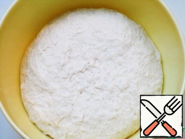 Continue kneading with your hands. The dough should be soft, if it sticks to your hands - brush with vegetable oil.